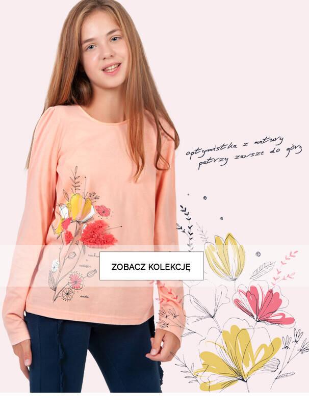 Baner z dziewczynką w kolorowej bluzce.