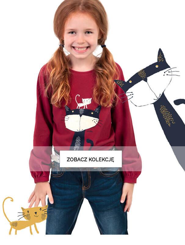 Baner z dziewczynką w bordowej koszulce.