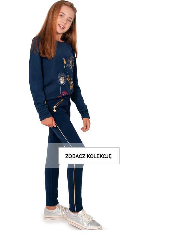 Baner z dziewczynką w granatowych legginsach z suwakiem w gwiazdki.