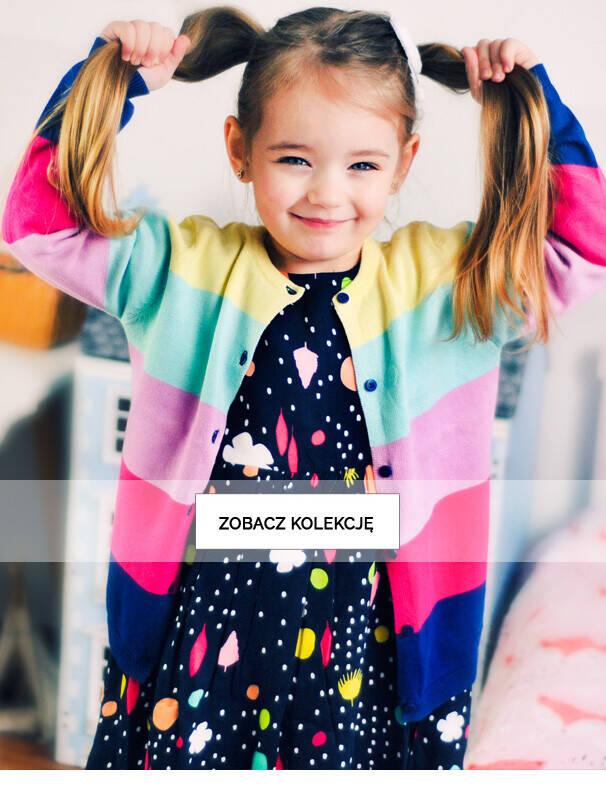 Baner z dziewczynką w kolorowym swetrze.
