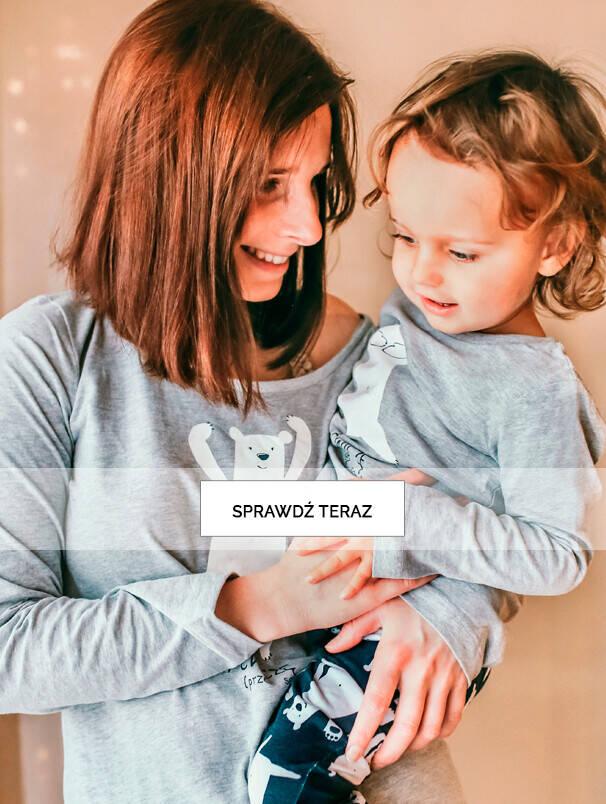 Baner z mamą i dzieckiem w piżamach.