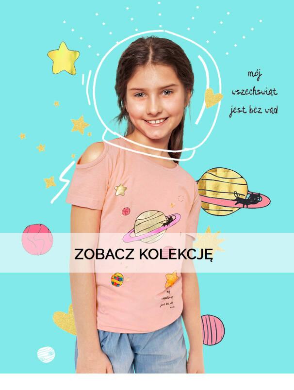 Baner z dziewczynką w kosmicznej koszulce.