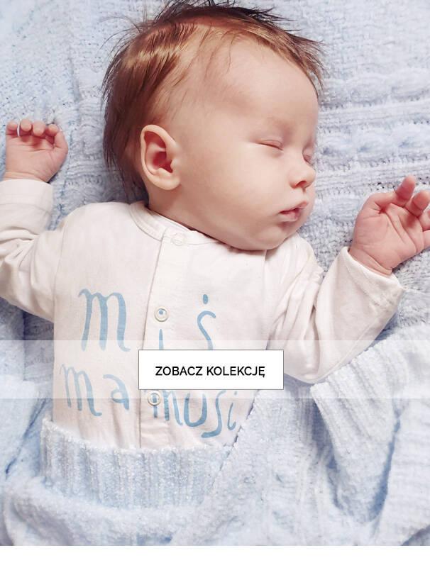 Baner ze śpiącym niemowlakiem.