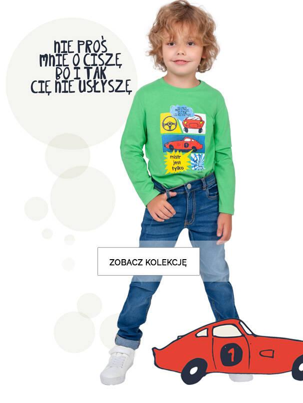 Baner z chłopcem w jeansach.