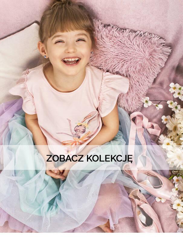 Baner z dziewczynką w różowej koszulce.