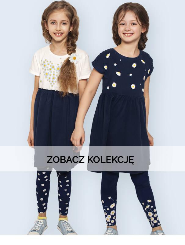 Baner z dziewczynkami w granatowych sukienkach i legginsach.