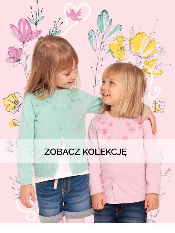 Baner z dziewczynkami w kolorowych swetrach.