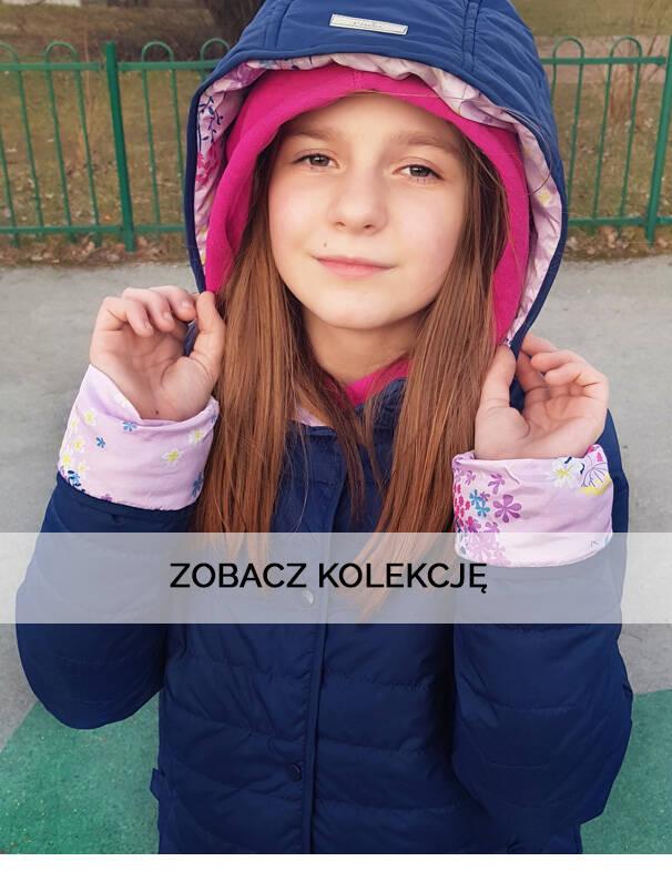 Baner z dziewczynką w wiosennej kurtce.