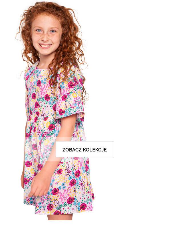 Baner z dziewczynką w sukience w kwiaty.