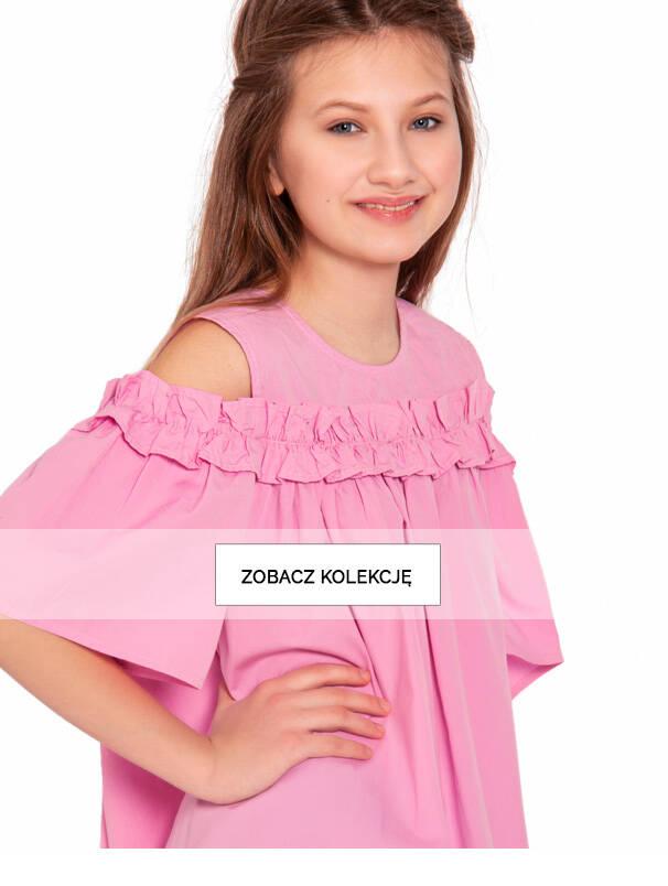 Baner z nastolatką w sukience różowej.