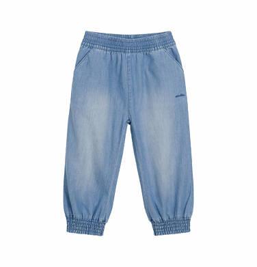 Spodnie jeansowe dla dziecka do 2 lat, luźny krój i ściągacze na nogawkach N03K041_2