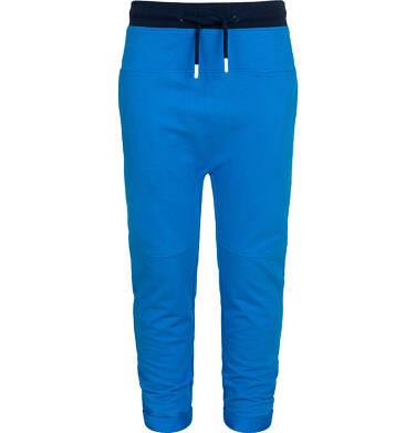 Spodnie dresowe dla chłopca, z obnizonym krokiem, niebieskie, 2-8 lat C05K026_1